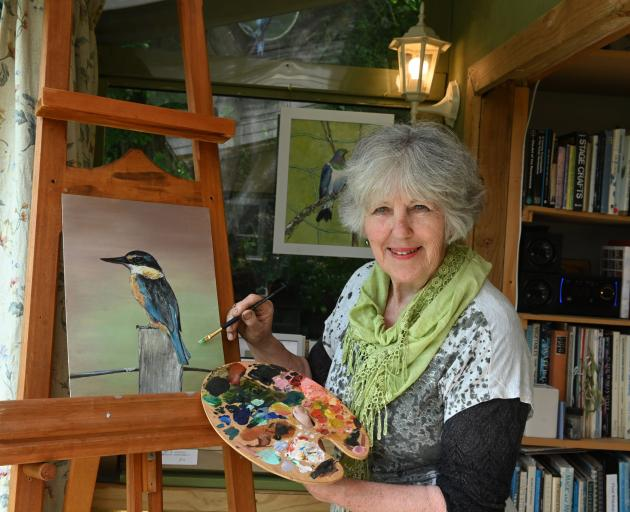 Mrs Jenkins works on a painting of a kingfisher. In the past 18 months, she has painted many New...