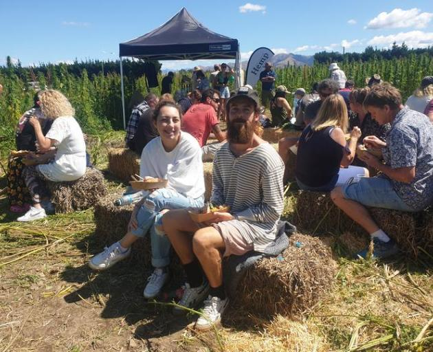 Liam O'Brien (centre) was among those who visited a Culverden hemp farm in the weekend to learn...