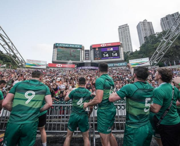 Ireland celebrates with fans after winning qualifier champion on day three of the Cathay Pacific/HSBC Hong Kong Sevens last year. Photo: Getty Images