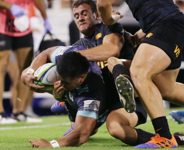 Asafo Aumua of Hurricanes is tackled by Emiliano Boffelli of Jaguares. Photo: Getty Images
