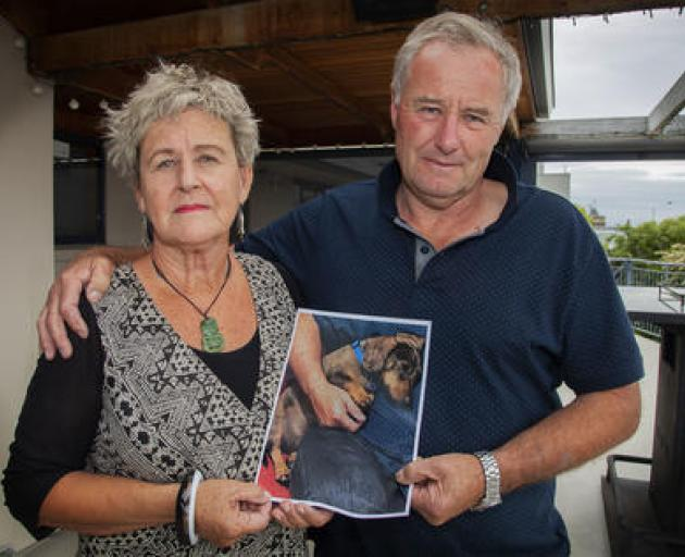 Jayne Abbott and her husband Bill with a photo of their dog Alfie who was killed in an dog attack...