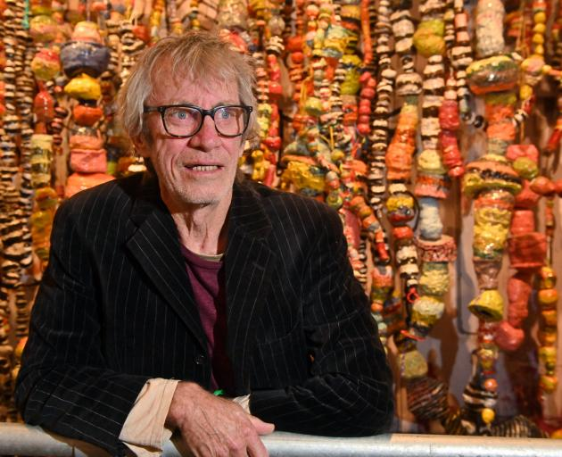 Jim Cooper with his new work 'No. 9: work made in a number nine year' at Otago Museum. Photo:...