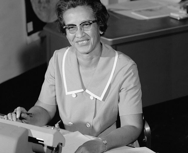 Nasa space scientist, and mathematician Katherine Johnson poses for a portrait at work at NASA Langley Research Center in 1966. Photo: Nasa via Getty Images