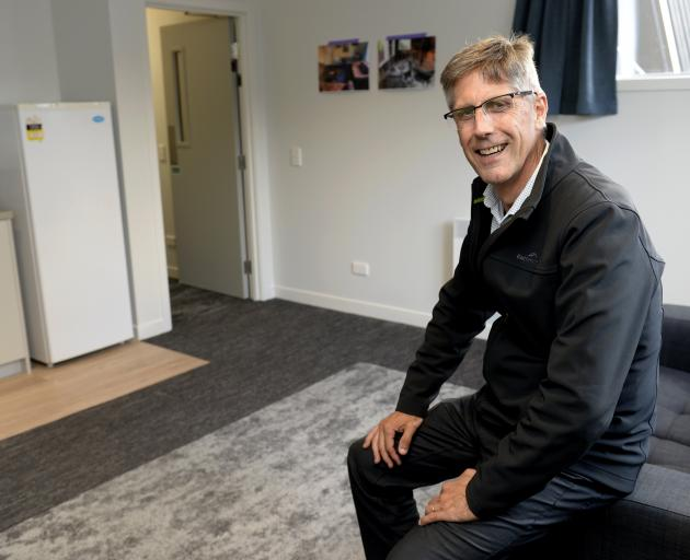 Knox College master Dr Graham Redding shows off one of the newly refurbished common rooms at the...