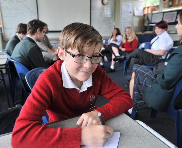 Seth Tulloch (14) prepares some notes to introduce himself to his new Whanau Group at Kaikorai Valley College yesterday. Photo: Christine O'Connor