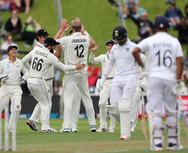New Zealand's Kyle Jamieson celebrates the wicket of India's Cheteshwar Pujura with teammates....