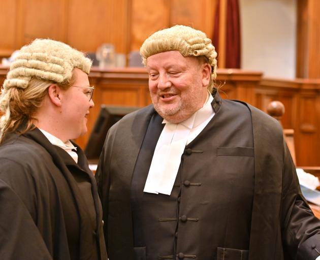 Barrister Cate Andersen congratulates her father, Len Andersen QC, in the High Court at Dunedin...