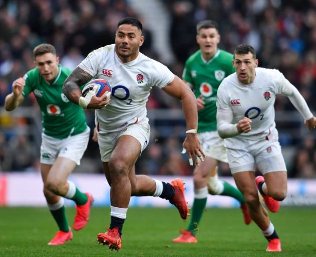 Manu Tuilagi makes a break for England against Ireland this morning. Photo: Getty Images