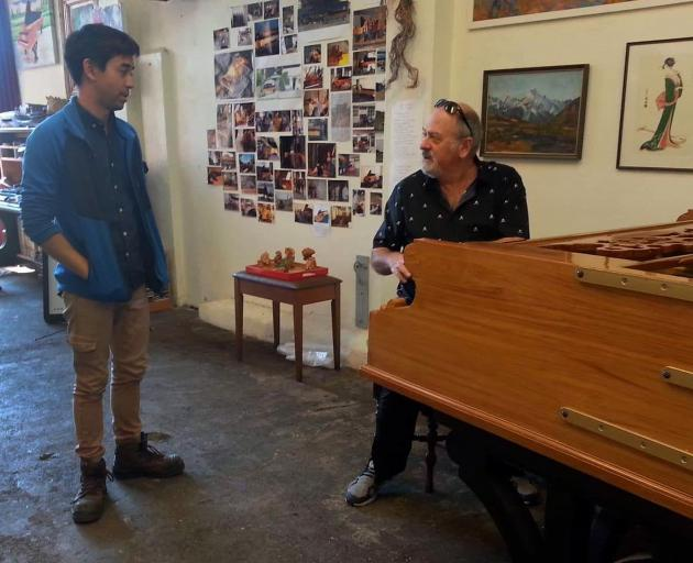 Dunedin man Adrian Mann (left) was shocked when Queen's keyboardist Spike Edney turned up to play the 6m-long piano Mr Mann made, following an email he had sent to Queen guitarist Brian May. Photo: Supplied