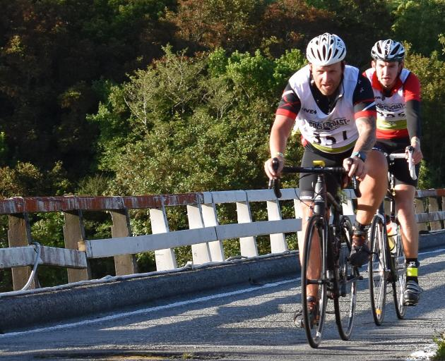 Cromwell's Nigel Lines leads Invercargill's Cameron Rogerson over the Taipo River bridge on the Coast to Coast race on Saturday. Photo: Wayne Parsons