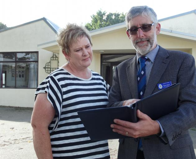 St Kevin's College hostel matron Lou Pearson and principal Paul Olsen look through possible plans...