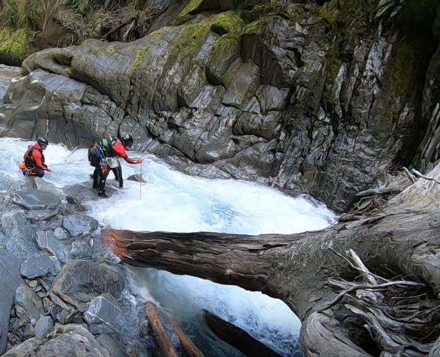 Wanaka Search and Rescue Swift Water and Canyon team probes Pyke Creek.