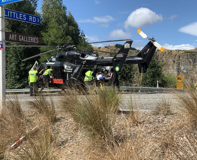 An Otago Rescue Helicopter crew picks up a cyclist at the bottom of the Coronet Peak access road...