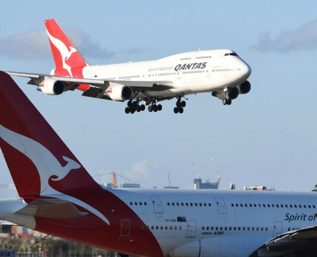 The cuts come as Qantas is celebrates 100 years of flying. Photo: Getty Images