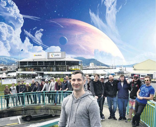 RocketWerkz founder Dean Hall and some of his team outside of their Dunedin HQ. IMAGE: GERARD O...