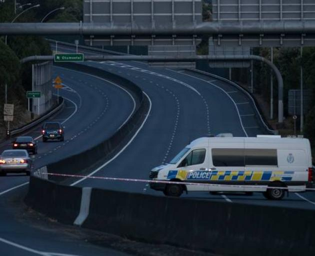 A police van at the police cordon on the closed SH2 in the early hours of Friday morning. Photo:...