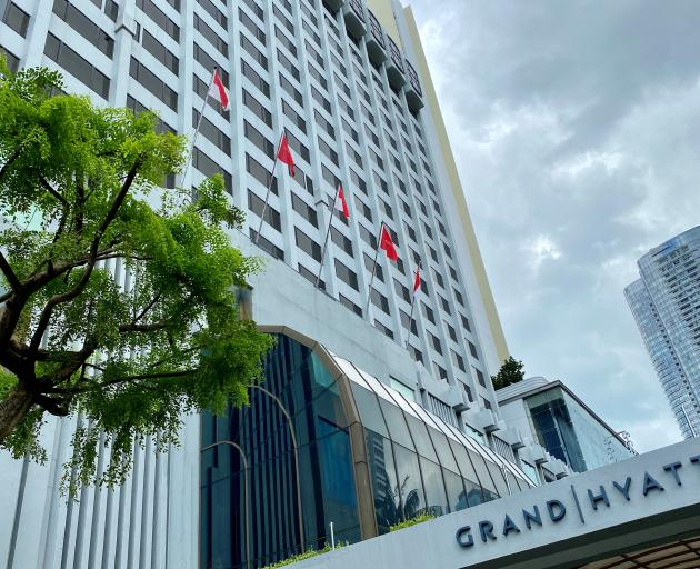 Management at the hotel - the Grand Hyatt Singapore - said they had cleaned extensively and were monitoring staff and guests for infection. Photo: Reuters