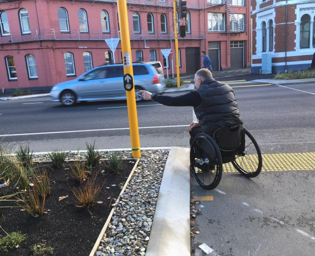 The traffic light button outside Toitu Otago Settlers Museum is put out of reach by awkward...
