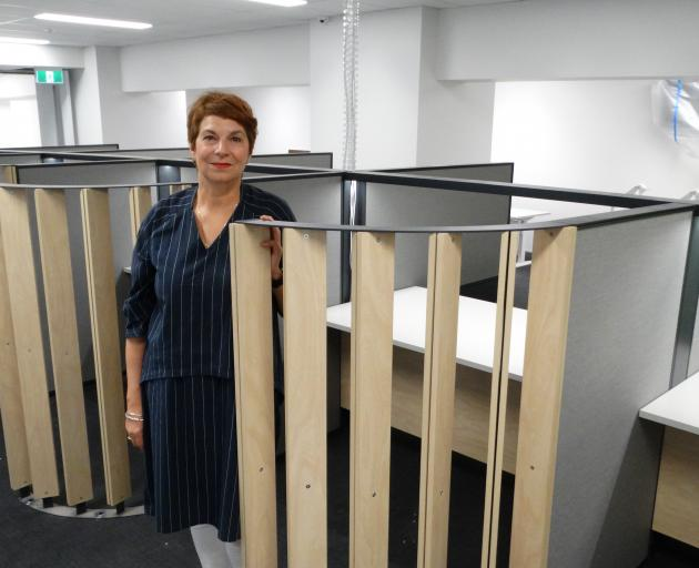 Ministry of Social Development service centre manager Robyn Dawson  checks out the cubicle spaces...