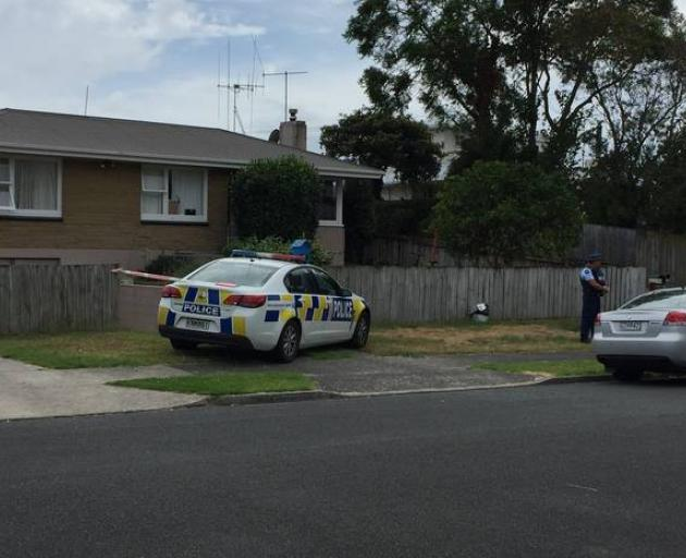 Police at the Lynwood Pl property in the Tauranga suburb of Brookfield on February 16, the day...