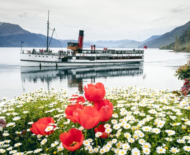 TSS Earnslaw cruises in front of the four-star Walter Peak garden. Photos: Supplied