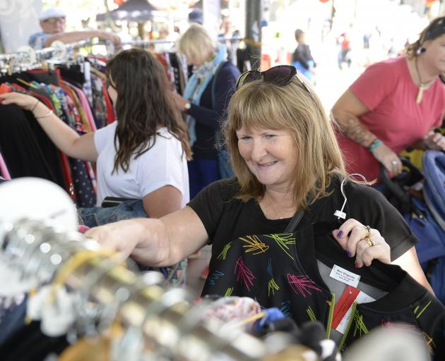 Lisa Davis looks through clothing at the Thieves Alley market. PHOTO: GREGOR RICHARDSON