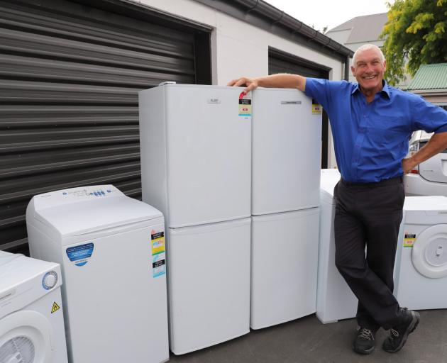Christchurch City Mission property officer Brendan Douglas with some of the whiteware. Photo:...