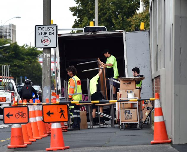 Movers are shifting items out of the Work and Income building on Castle St ready for the new...