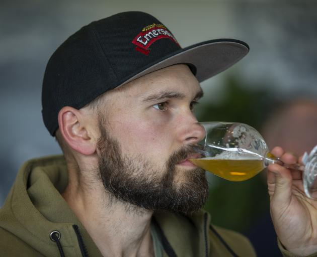 Emerson's brewer Mason Pratt judges the aroma and flavour of a beer. Photo: Peter Meecham