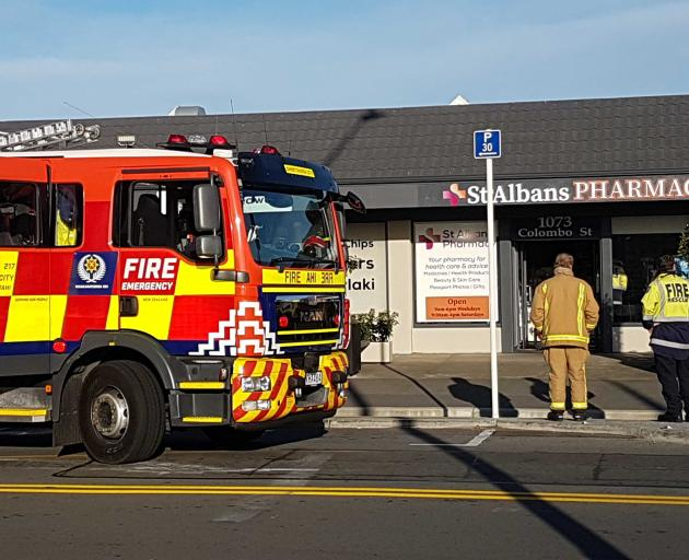 There is a fire at the St Albans Pharmacy on Colombo St this morning. Photo: Geoff Sloan