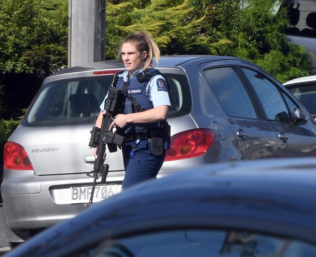 An armed police officer on Leith St today. Photo: Stephen Jaquiery