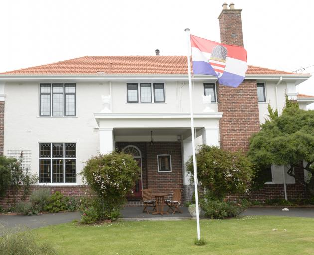 The flag of Kronberg, Ms Reymann's home city in Germany, flies near the entrance.