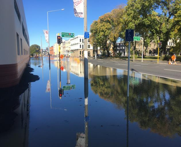 The water main burst spewing water out on to SH1 in Dunedin. Photo: Stephen Jaquiery