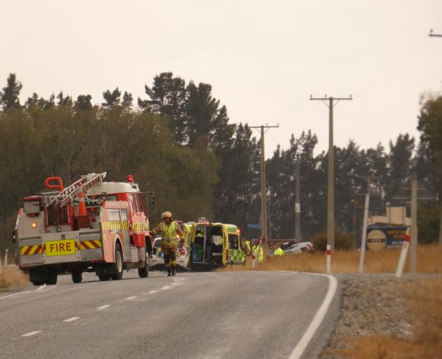 Emergency services attend the scene of a serious crash on SH85, near Becks. Photo: Alexia Johnston