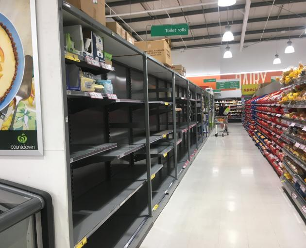 Shelves usually holding toilet rolls were empty at Dunedin central Countdown on Saturday. Photo:...