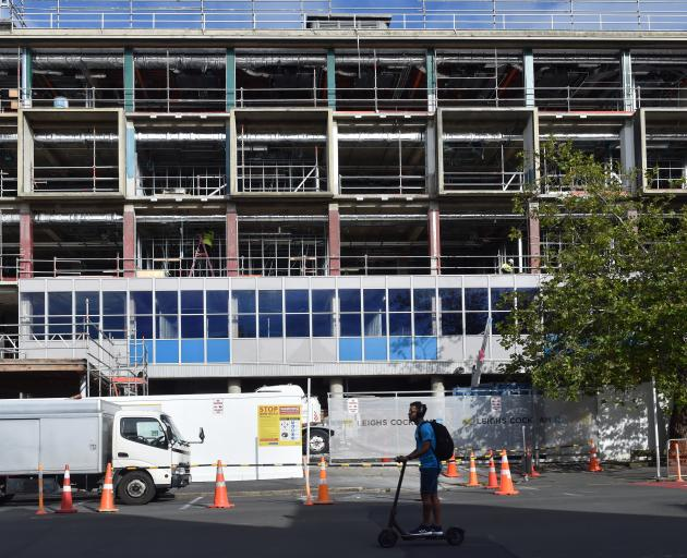 Contractors have started installing a replica coloured glass facade on the University of Otago's...