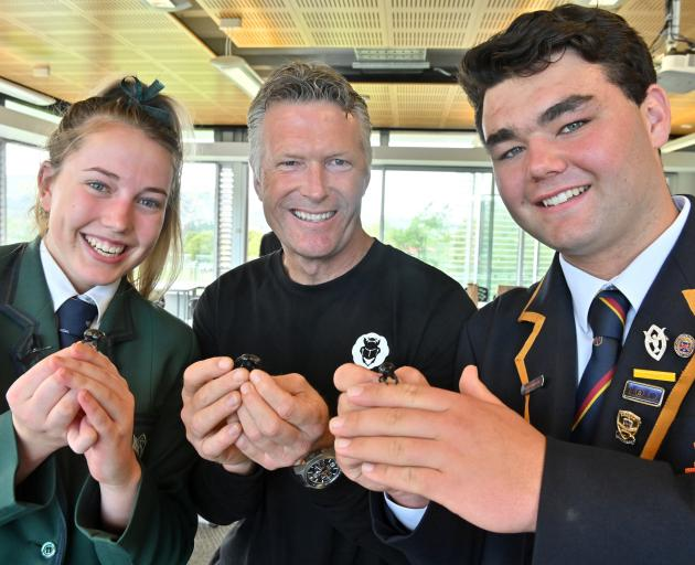 Holding dung beetles are (from left) Columba College pupil Megan Hanning (16), Dr Shaun Forgie of...