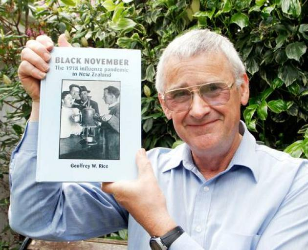 "Dr Geoffrey Rice with a copy of 'Black November"" - his book about the 1918 pandemic. Photo: ODT"