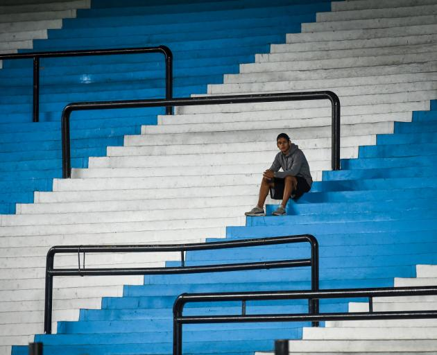 A ballboy waits in the empty stands of Presidente Peron Stadium before a Copa Libertadores football game in Avellaneda, Argentina, last week. The game was played behind closed doors to prevent the spread of Covid-19. Photo: Getty Images