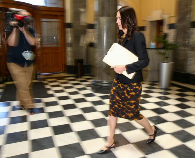 Prime Minister Jacinda Ardern walks to the House yesterday to declare a State of National Emergency. Photo: Getty Images