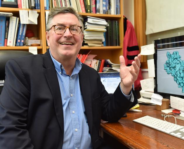 Prof Kurt Krause with an image of a coronavirus protein used in reproduction. PHOTO: GREGOR...