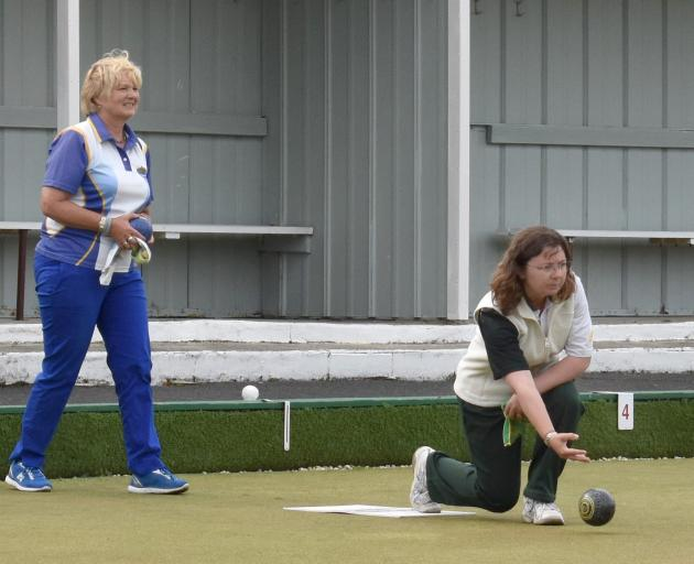 Lee Grigg (Green Island) is in her delivery stride as Beth Brown (Taieri) looks on anxiously....