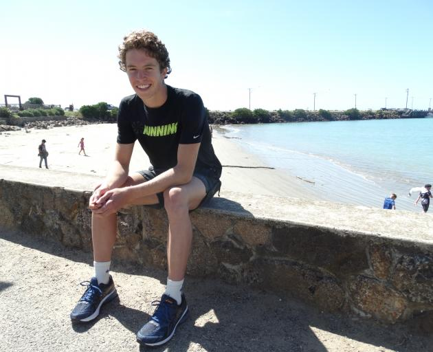 Austin Carter relaxes at Friendly Bay, Oamaru, after winning the men's open section of the Oamaru...