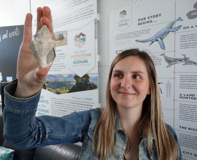 Waitaki Whitestone Geopark Trust geopark co-ordinator Lisa Heinz admires a several million-year...