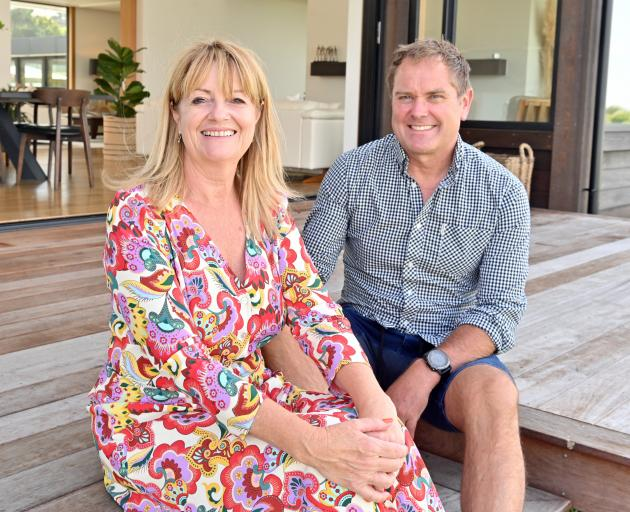 After years of living in their garage, Carol Williamson and Judd de la Roche say it is nice to be...