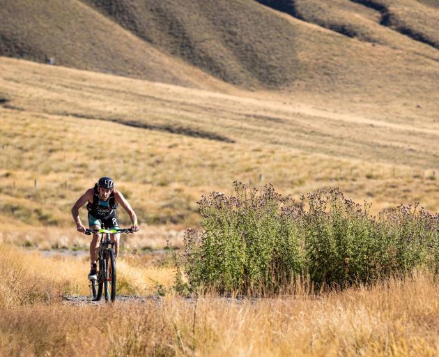 Sam Osborne bikes in the Motatapu triathlon event on Saturday. Photo: Tim Bardsley-Smith