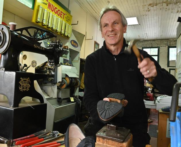 Paul Ayers repairs footwear in his Stuart St premises before making home deliveries to customers. Photo: Christine O'Connor