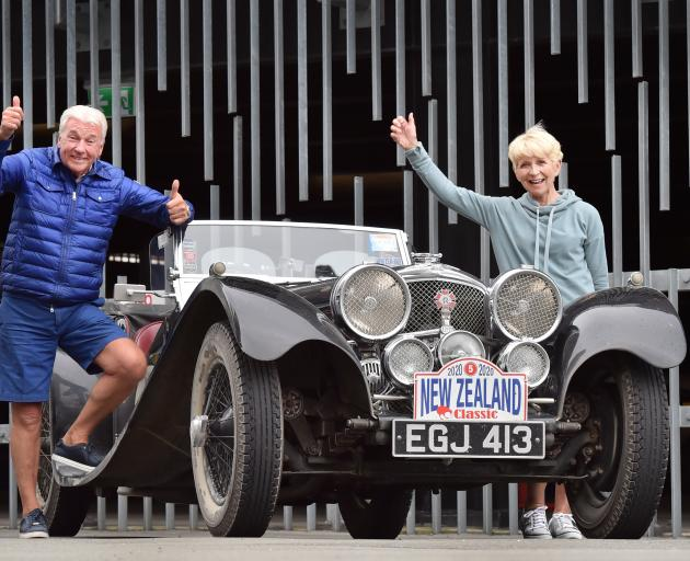 Pit stopping in Dunedin in their 1937 Jaguar SS100, worth $1.3million, are Stephen and Collette...