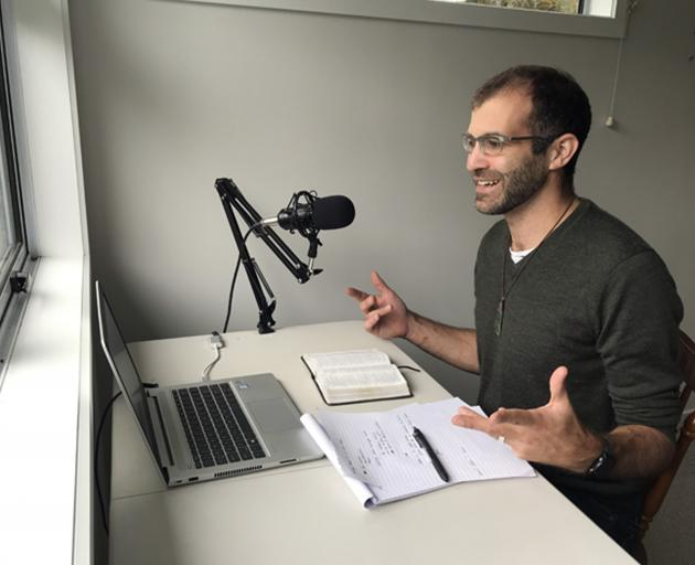 The Rev Ed Masters, of First Church of Otago, at his desk where he prepares podcast messages to...