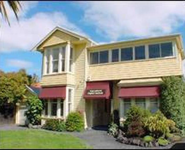Officials took the woman away from the Rucksackers backpackers' hostel in Christchurch today.